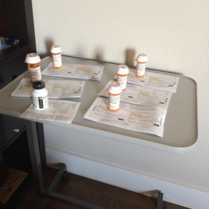 All my prescriptions on my new bed table.